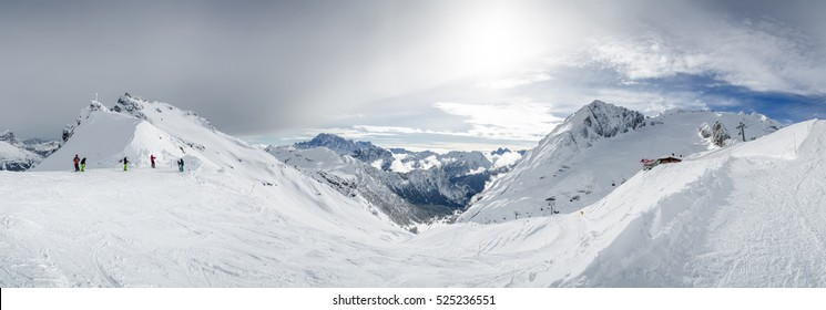 Sunny panoramic view of Dolomites from one of ski slopes, Trentino-Alto-Adige region, Italy.