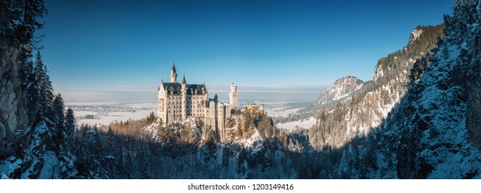 Sunny panoramic view of Neuschwanstein castle at foggy morning, Bavaria, Germany.