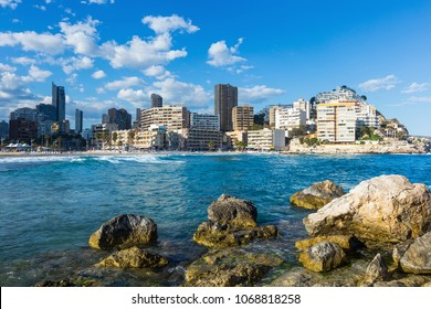 sunny panoramic view on Benidorm city with seafront and modern skyscrapers
