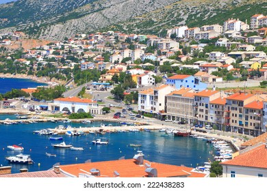 Sunny pier and buildings of an old town near the Adriatic sea, Senj, Croatia