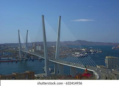 Sunny port city, big beautiful guys across the Bay Bridge