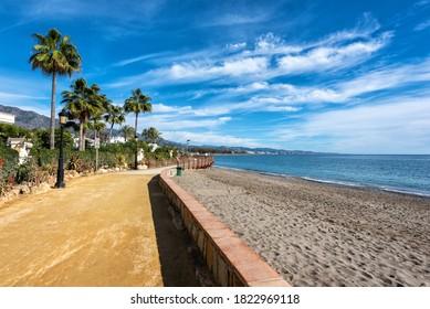 Sunny promenade along coastline between Marbella and Puerto Banus towns, Spain
