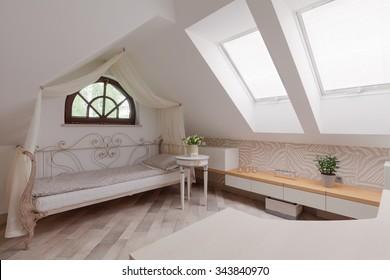 Sunny room in the attic in romantic style