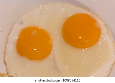Sunny Side Up eggs. A fried egg is a cooked dish commonly made using a fresh hen's egg, Fried eggs are traditionally eaten for breakfast and also be served at other times of the day.