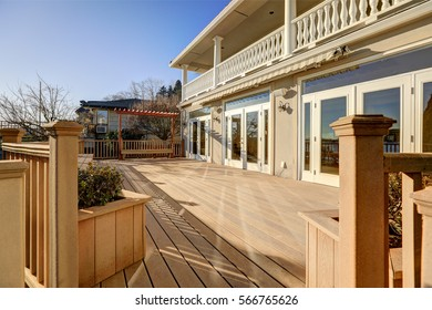 Sunny spacious walkout deck of luxurious waterfront home. Northwest, USA