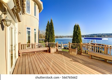 Sunny spacious walkout deck of luxurious Mediterranean style waterfront home overlooking picturesque view of Lake Washington. Northwest, USA