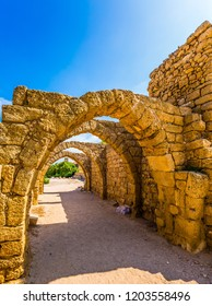 Sunny spring day. Arched passage - covered street of Port of Caesarea. Ruins of the ancient city of Caesarea. Israel. Concept of ecological and historical tourism