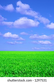 A sunny spring day with blue sky and scattered clouds