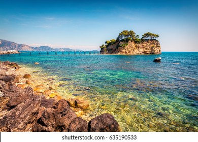Sunny spring view of the Cameo Island. Picturesque morning scene in the Port Sostis, Zakynthos (Zante) island, Greece, Europe. Beauty of nature concept background.