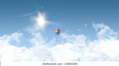 Sunny summer background with clear blue sky, balloons and aeroplane - great copy-space for posters, cards or banners