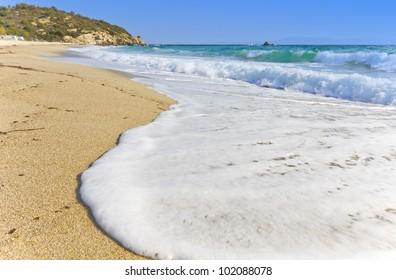 Sunny summer beach at the mediterranean coast in Greece
