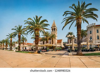 Sunny summer cityscape of Trogir. Empty moning street view of old Adriatic town. Beautiful world of Mediterranean countries. Traveling concept background.