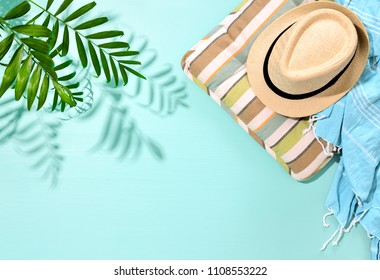 Sunny summer concept background with a strong shadow of palm leaf and blank space for a text, view from above, flat lay composition