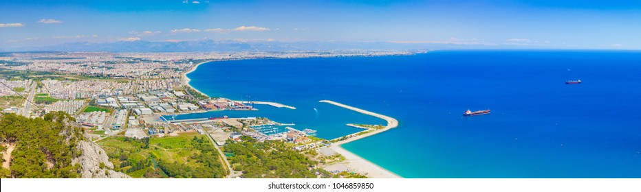 Sunny summer day with blue sky and clear sea in Antalya. Aerial panoramic view of beautiful blue sea and popular seaside resort city Antalya, Turkey.