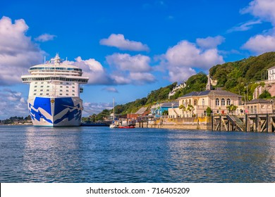 A sunny summer day in Ireland. With a view on the romantic town Cobh. On the background a cruise liner. September 2017 Cork, Ireland.
