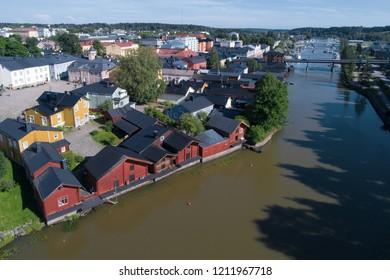 Sunny summer day over the river Porvonjoki river (shot from quadcopter). Old Porvoo, Finland
