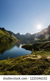 Sunny summer evening by lake Agvatnet on the Lofoten islands, Norway.