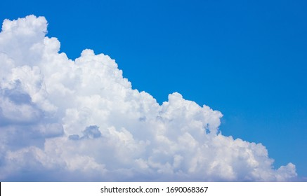 In sunny summer, huge clouds float on the blue sky.