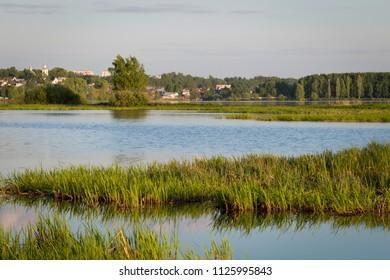 Sunny summer landscape. River Volga in Kostroma, Russia.