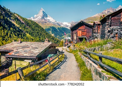 Sunny summer morning in Zermatt village with Matterhorn (Monte Cervino, Mont Cervin) peak on backgroud. Beautiful outdoor scene in  Swiss Alps, Valais canton, Switzerland, Europe.