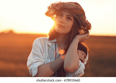 Sunny summer portrait of a beautiful woman
