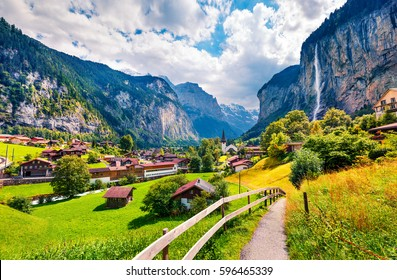 Sunny summer view of great waterfall in Lauterbrunnen village. Splendid outdoor scene in Swiss Alps, Bernese Oberland in the canton of Bern, Switzerland. Beauty of countryside concept background.
