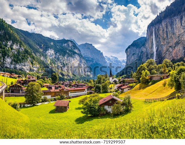 Sunny summer view of great waterfall in Lauterbrunnen village. Splendid outdoor scene in Swiss Alps, Bernese Oberland in the canton of Bern, Switzerland, Europe. Traveling concept background.