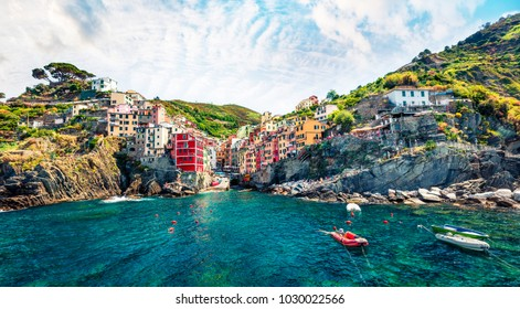 Sunny summer view of  Riomaggiore - Cique Terre sequence of hill cities. Wonderful morning view of Liguria, Italy, Europe. Splendid spring seascape of Mediterranean sea. Traveling concept background.