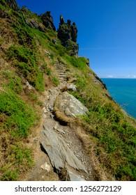 Sunny summer views from near Bolt Head over Starehole Bay, towards the Salcombe estuary and Prawle Point, Devon, UK