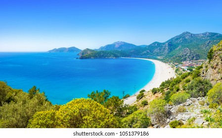 Sunny summer weather with clear blue sky in Oludeniz. Aerial view of beautiful blue lagoon and beach in Oludeniz, Fethiye district, Turquoise Coast of southwestern Turkey