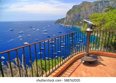 Sunny terrace with a telescope high above the sea in Capri, Capri island, Italy