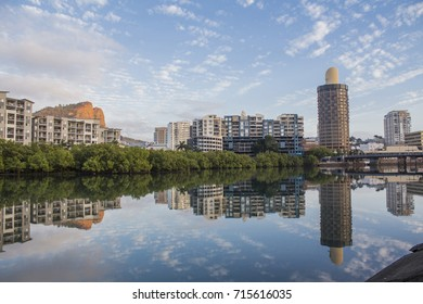 Sunny Townsville in Northern Queensland. The CBD reflecting on the Ross Creek.