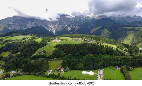 Sunny view of alpine Leogang village. Picturesque scene. Popular tourist attraction. Austrian alps, Saalfelden. Salzburg, Europe. Beautiful green summer meadow. Aerial drone photography. Beauty world.