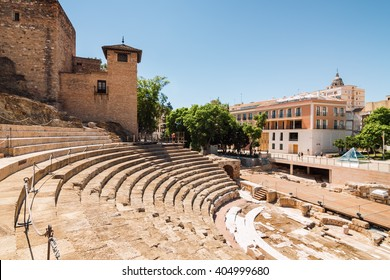 Sunny view of ancient amphitheater Teatro Romano de Malaga, Andalusia province, Spain.