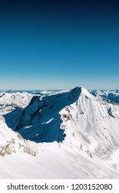 Sunny view of Austrian Alps from viewpoint of ski resort Zillertal Hintertuxer Glacier, Tirol, Austria.