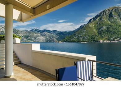 Sunny view of Boka Kotor bay from coastal cafe near Perast, Montenegro.