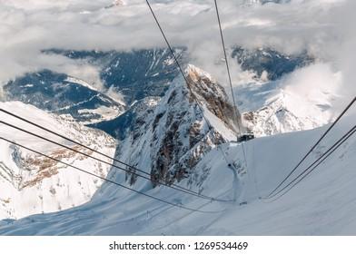 Sunny view of Dolomites from Marmolada glacier of Arabba, Trentino-Alto-Adige region, Italy.