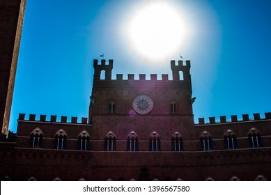 Sunny view of Piazza del Campo (Campo square), Palazzo Publico and Torre del Mangia (Mangia tower) in Siena, Tuscany, Italy.  The historic centre of Siena has been declared by UNESCO a World Heritage.