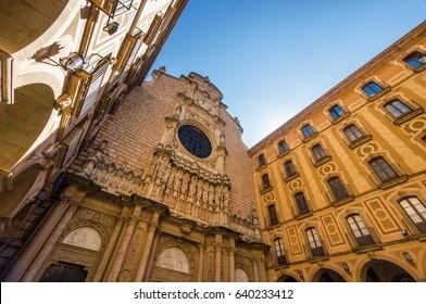 Sunny view of Santa Maria de Montserrat Abbey in Monistrol de Montserrat, Catalonia, Spain.