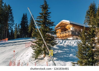 Sunny view of ski slope and chalet at Col Rodella valley near Canazei of Val di Fassa, Trentino-Alto-Adige region, Italy.
