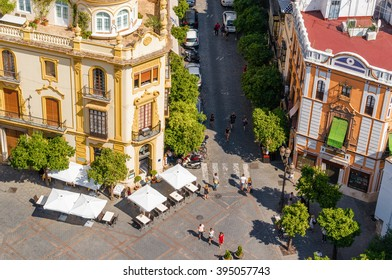 Sunny view of street cafe on square from viewpoint of Giralda in Sevilla, Andalusia province, Spain.
