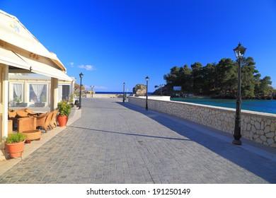 Sunny walkway and tavern near the Ionian sea, Greece