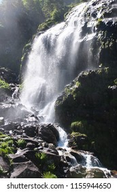 Sunny waterfall background at the Cascade d'Ars on the GR10 trail in the Pyrenees, France