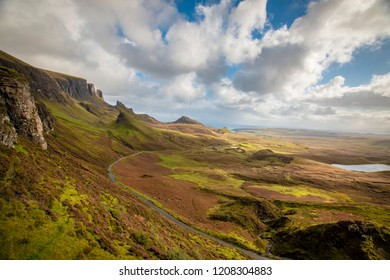 Sunny weather in Scotland, watching over the popular viewpoint Quiraing with beautiful sunspots on the landscape