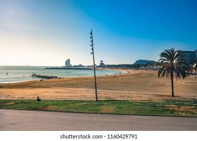 Sunny winter day on Barceloneta beach. Barcelona, Spain