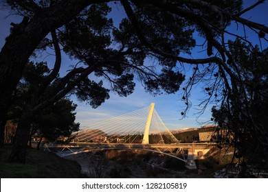 Sunny winter day on river Moraca (Morača) at sunset in Podgorica. Millenium bridge is a symbol of the Montenegrin capital.