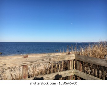 A sunny winter day overlooking Long Island Sound from a view platform at Caumsett State Park in Lloyd Neck, Huntington, Long Island, NY.