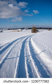 sunny winter scenery with snowy country road in rural landscape, bavaria