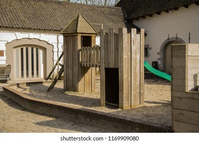Sunny a wooden children playground. The Stock Photo.