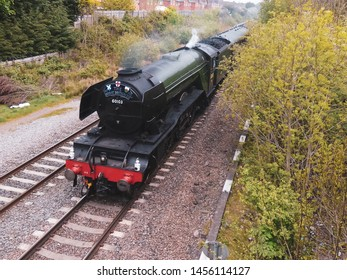 Sunnyhill, Derby United Kingdom May, 5 2019. Steam Locomotive Flying Scotsman leaving Derby at Sunnyhill on an charter excursion train in May 2019.
